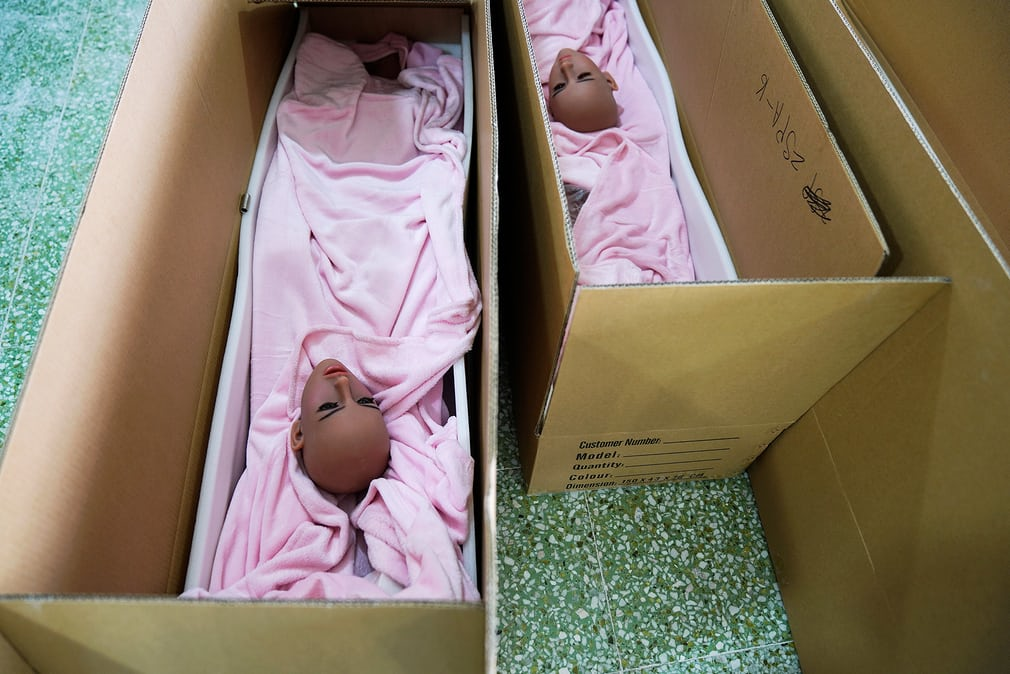 Dolls' heads are put in boxes ready to ship to customers. The company hopes the AI dolls will eventually take off with overseas customers, including in the US. Exports account for 80% of its sales, and half of its overseas shipments go to the US