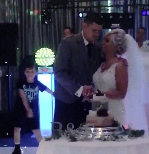 Video: Boy Upstages His Newly-Wed Parents By Flossing As They Cut Wedding Cake