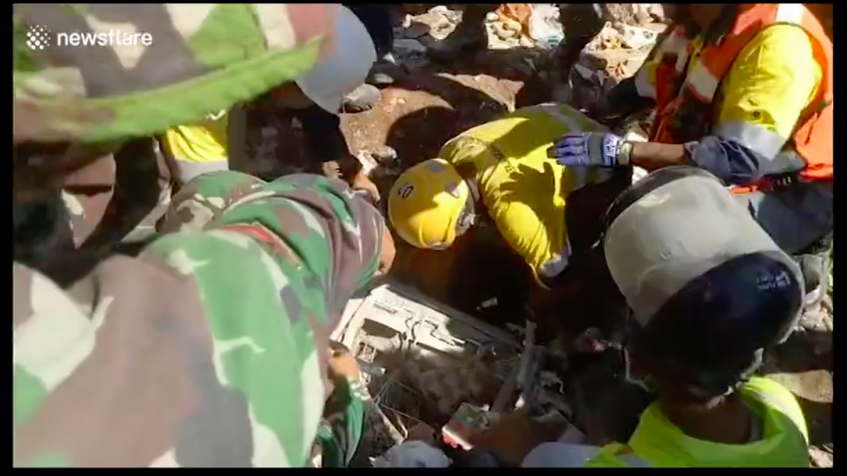 Dramatic moment high-school student pulled from rubble three days after Indonesia quake
