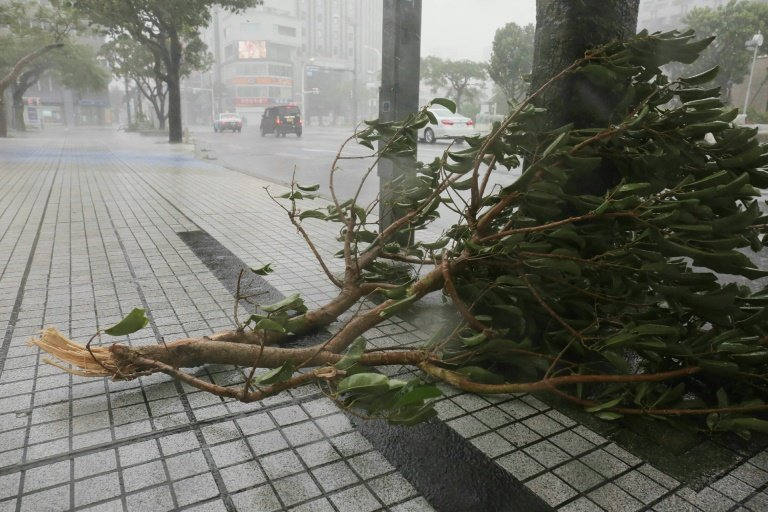Powerful typhoon batters Okinawa, churns to Japan mainland