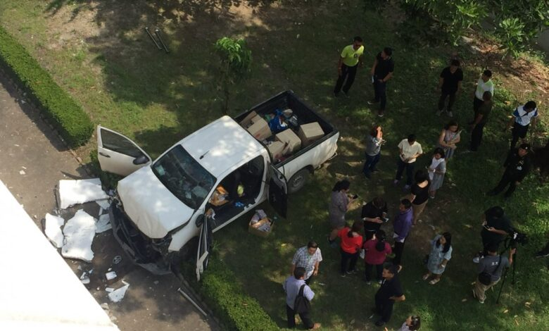 Pickup falls from six-floor carpark. A pickup truck driver reversed and