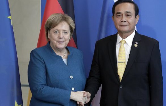 Merkel encourages Thai PM to lead his country to democracy.