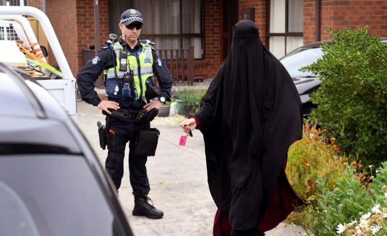 """Three charged over alleged Melbourne terror plot. Three men who allegedly plotted """"chilling"""" terror attacks in Melbourne were charged early Tuesday"""
