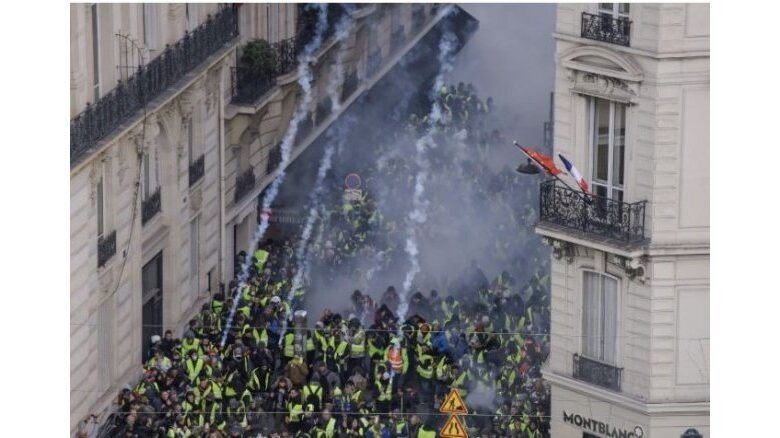 Clashes, tear gas near Champs-Elysees at Paris 'yellow vest' protests. Paris riot police clashed on Saturday near the famous Champs-Elysees boulevard