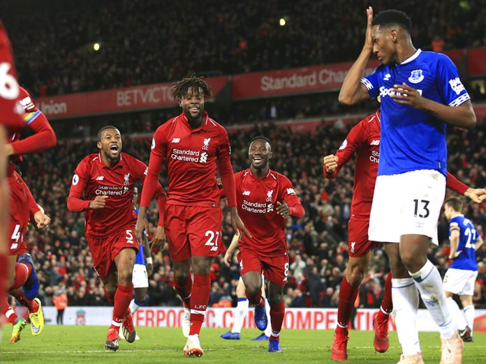 Liverpool, Arsenal, Chelsea win on dramatic derby day in EPL. Liverpool defender Virgil van Dijk turned away in disgust. The Kop fell silent in