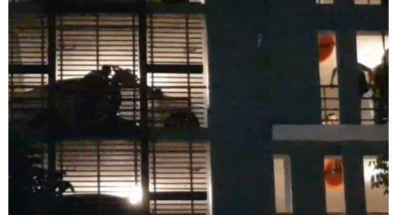 Man dies in condo car park with charcoal at his side