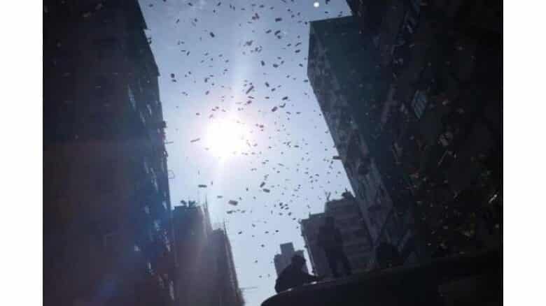 Money falls from sky onto busy Hong Kong street. What would you do if money started falling from the sky? People in Hong Kong witnessed the