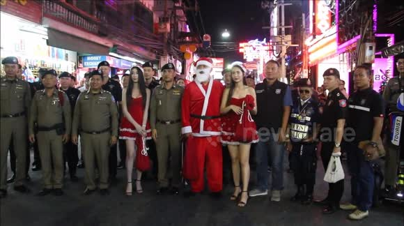 Police, Models & Candy Sticks On Walking Street For Christmas Eve. Police were joined by two models in Santa costumes as they handed out candy sticks
