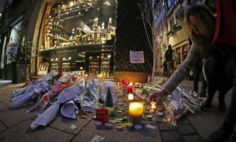 Shooting aftermath in Strasbourg. People light candles and leave signs and flowers on a place close to the Christmas Market where a shooting