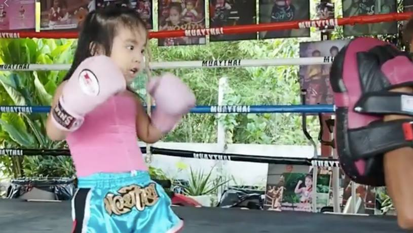This little girl may seem young and small, but she's a tiny Muay Thai master