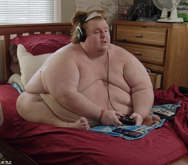 'I will eat till I die'. 700LB man, 34, who has to bathe in an outdoor TROUGH 'like a pig' reveals he spends all day playing video games