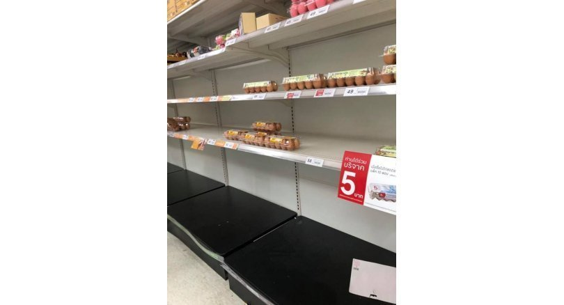 People stock up on food and basic supplies