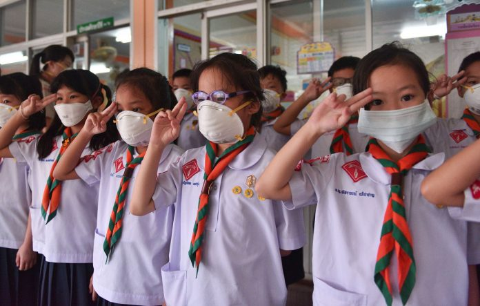 SOME BANGKOK SCHOOLS CANCEL CLASSES DUE TO POLLUTION. Western students have snow days off from school, Thai students have flood