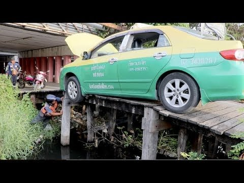 Taxi Driver Gets Stuck After Driving Over Wooden Footbridge