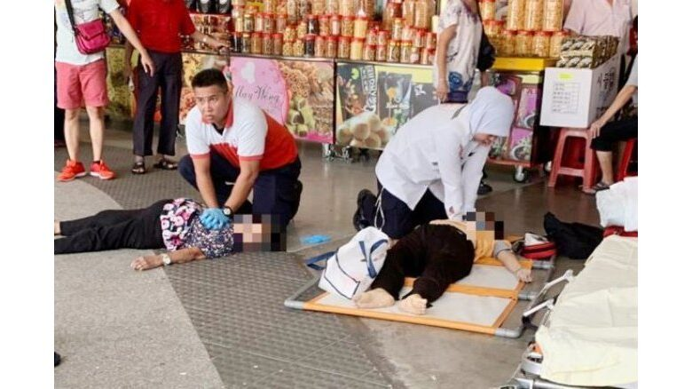 Two elderly women killed as crowd rushes for free food coupons in Malaysia. Two elderly women died when a large crowd rushed to get free food coupons