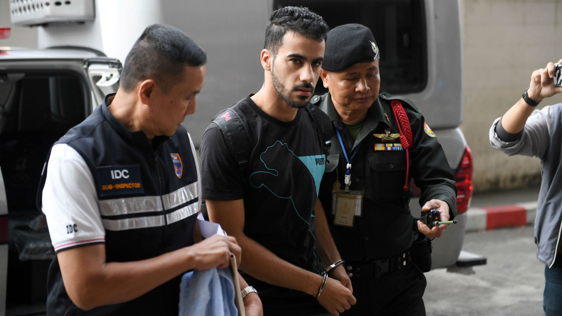 Bahrani football player being held in Thailand continues to draw global attention, will be held until at least mid April A refugee footballer who