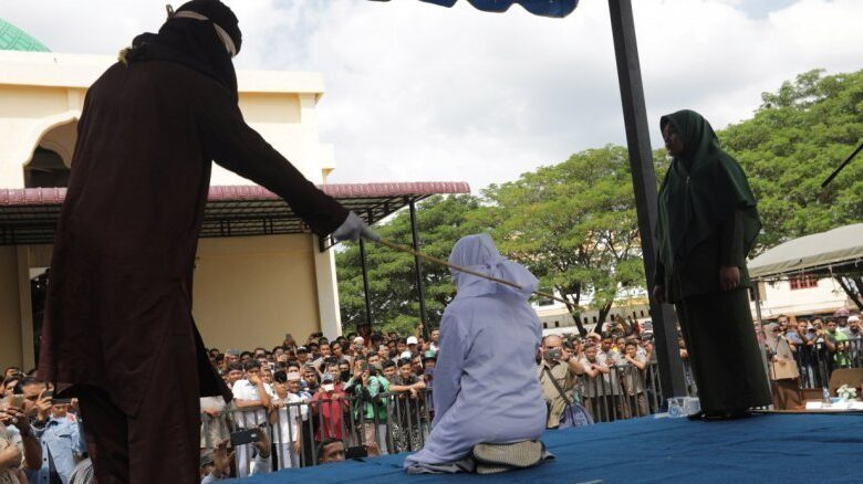 Indonesia's Aceh whips teens for public cuddling. Two teenagers were whipped in Indonesia's Aceh province on Thursday after they were caught