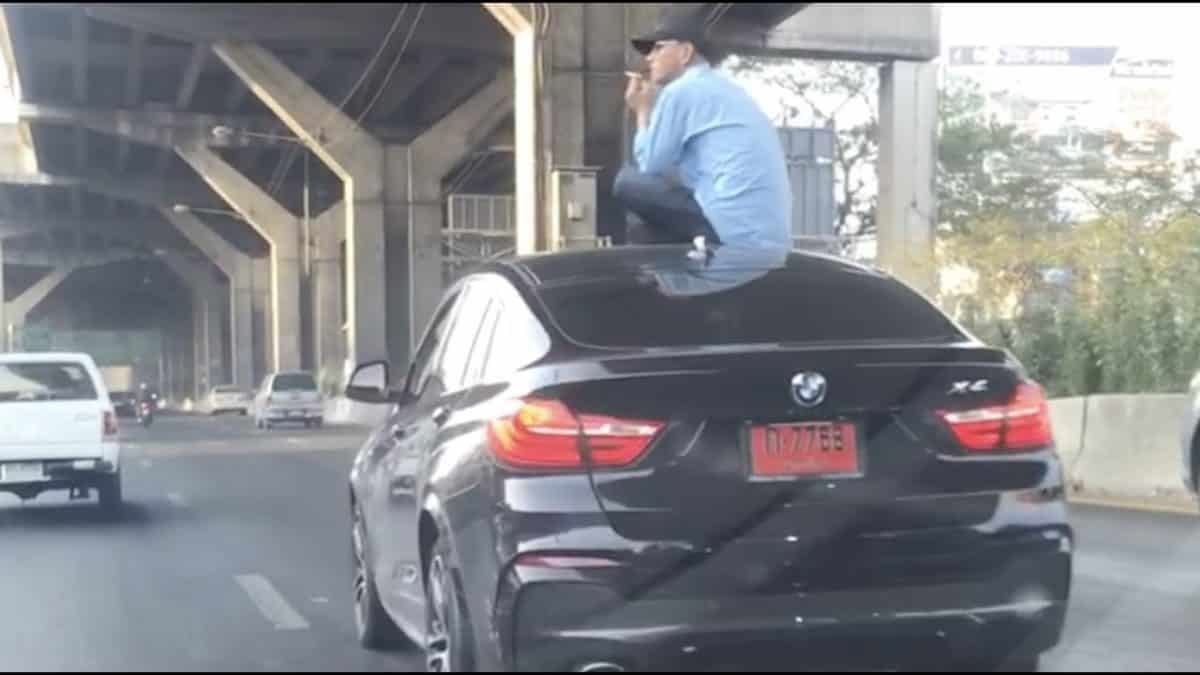 Driver Sits On Car Roof After Crash