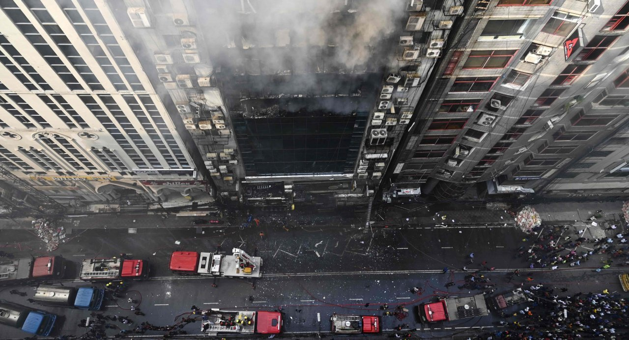 Workers jump to their deaths as Dhaka office block fire kills. Desperate workers leaped to their deaths, as a huge fire tore through a Dhaka office block