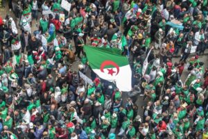 Algerians abroad return home, seeing hope in protest movement. For weeks, expat Algerians have been streaming home, some just for the weekend, to play their