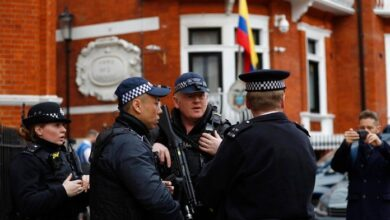 UK police outside Ecuador embassy amid WikiLeaks tweets. British police stationed armed officers outside the Ecuadorian Embassy in London on Friday