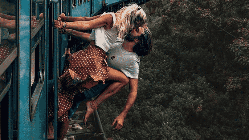 """Couple Criticised For Photo Of Them Kissing Hanging From A Moving Train. A couple have received criticism online for sharing aphotoof their """"wildest"""