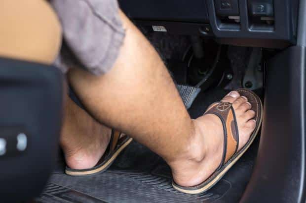 FLIPPING OUT How driving in flip flops could land you a £5,000 fine, NINE penalty points and a road ban