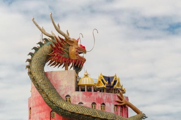 Giant dragon guards temple in Thailand. Giant dragon guards temple in Thailand – but it has another hidden purpose. Thailand is home to some of the
