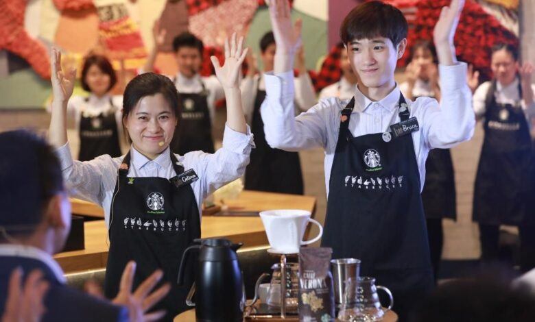 Starbucks opens first store with sign language capability in China For hearing impaired customers at a Starbucks in Guangzhou's Yuexiu district, ordering