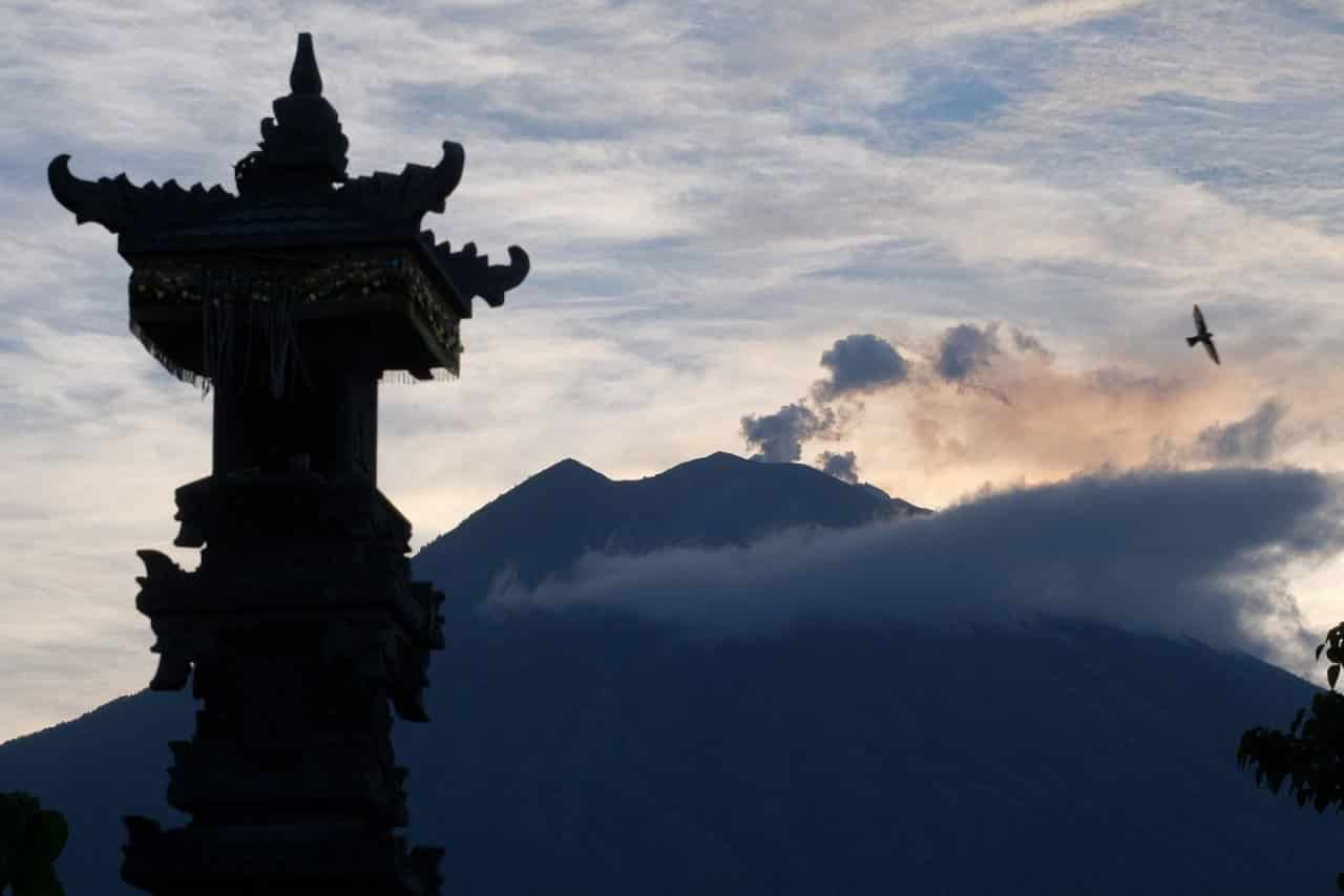 Volcano on Indonesia's Bali erupts, flights canceled. Bali's volcano of Mount Agung erupted Friday, spewing ash and hot lava that ran down 3 km from