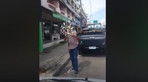 "Foreigner places no parking sign on public road in Pattaya. A foreigner was filmed in Pattaya placing a ""customers only"" parking sign in front of a famous"