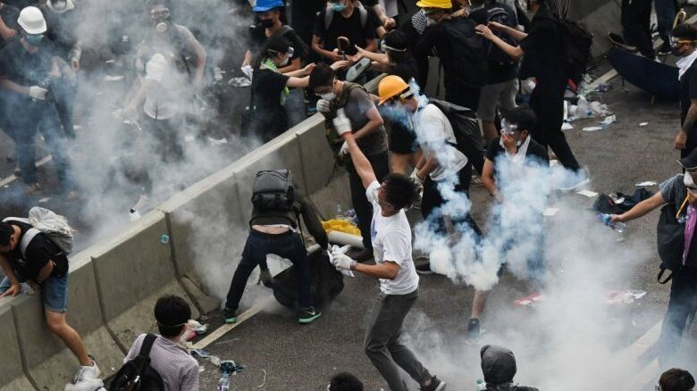 Hong Kong police use tear gas as protesters try to storm parliament. Violent clashes broke out in Hong Kong on Wednesday as police tried to stop protesters