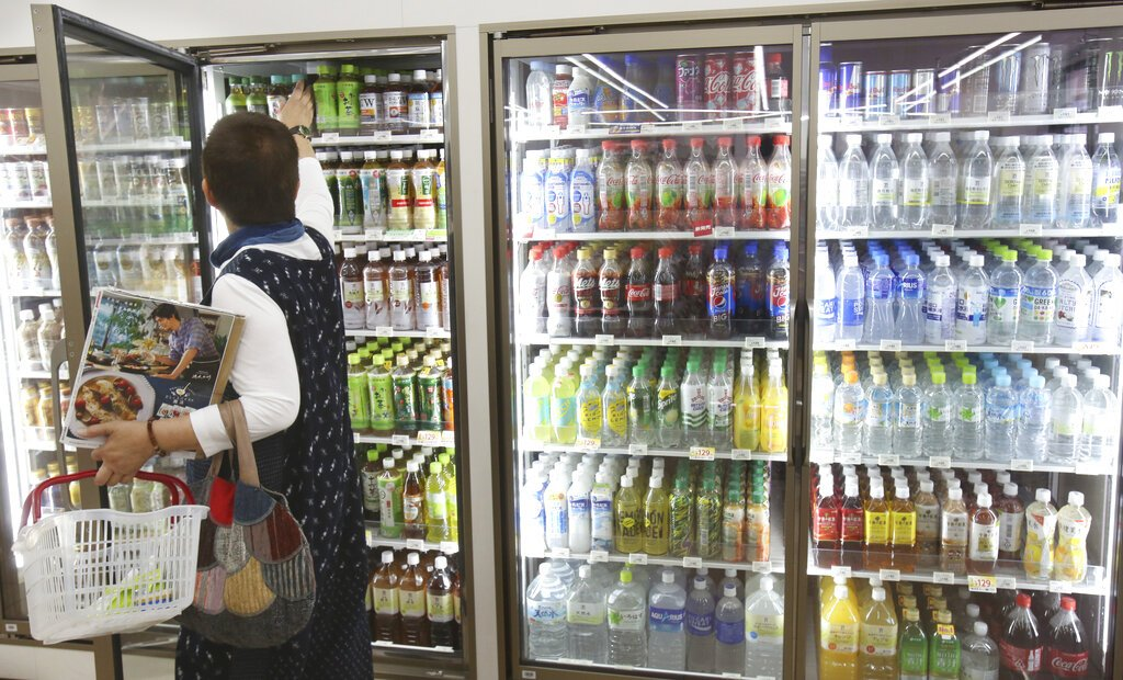 In this June 17, 2019, photo, plastic-bottled soft drinks are displayed in fridges at a Seven-Eleven store in Yokohama, near Tokyo. Photo: Koji Sasahara / AP