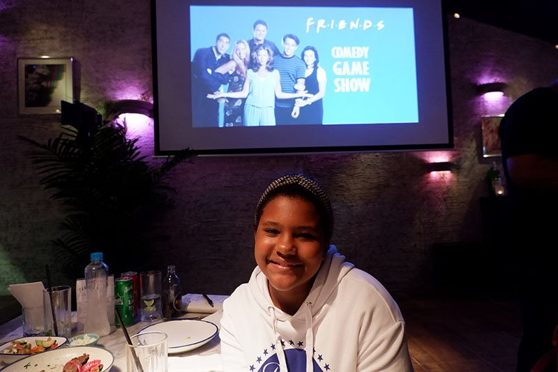 """Myla Reis de Soaza, a 10-year-old Brazilian-Indian and sixth grader at St. Andrews International School, came to the trivia night with her family, including grandma Latmi Dialdas, 64. She's watched the entire show 16 times, she says. Other than the humor, friendships, and her favorite character Joey, the show has given her a glimpse into '90s tech. """"I didn't know you could make calls from that kind of telephone,"""" she said, referring to a home phone. """"There were also those flip phones, and in one episode Phoebe pulled out a really big phone from her purse."""""""