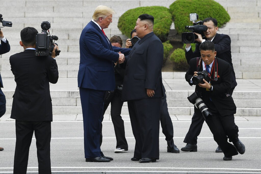 President Donald Trump walks to the North Korean side of the border with North Korean leader Kim Jong Un at the border village of Panmunjom in the Demilitarized Zone, South Korea, Sunday, June 30, 2019. Photo: Susan Walsh / AP