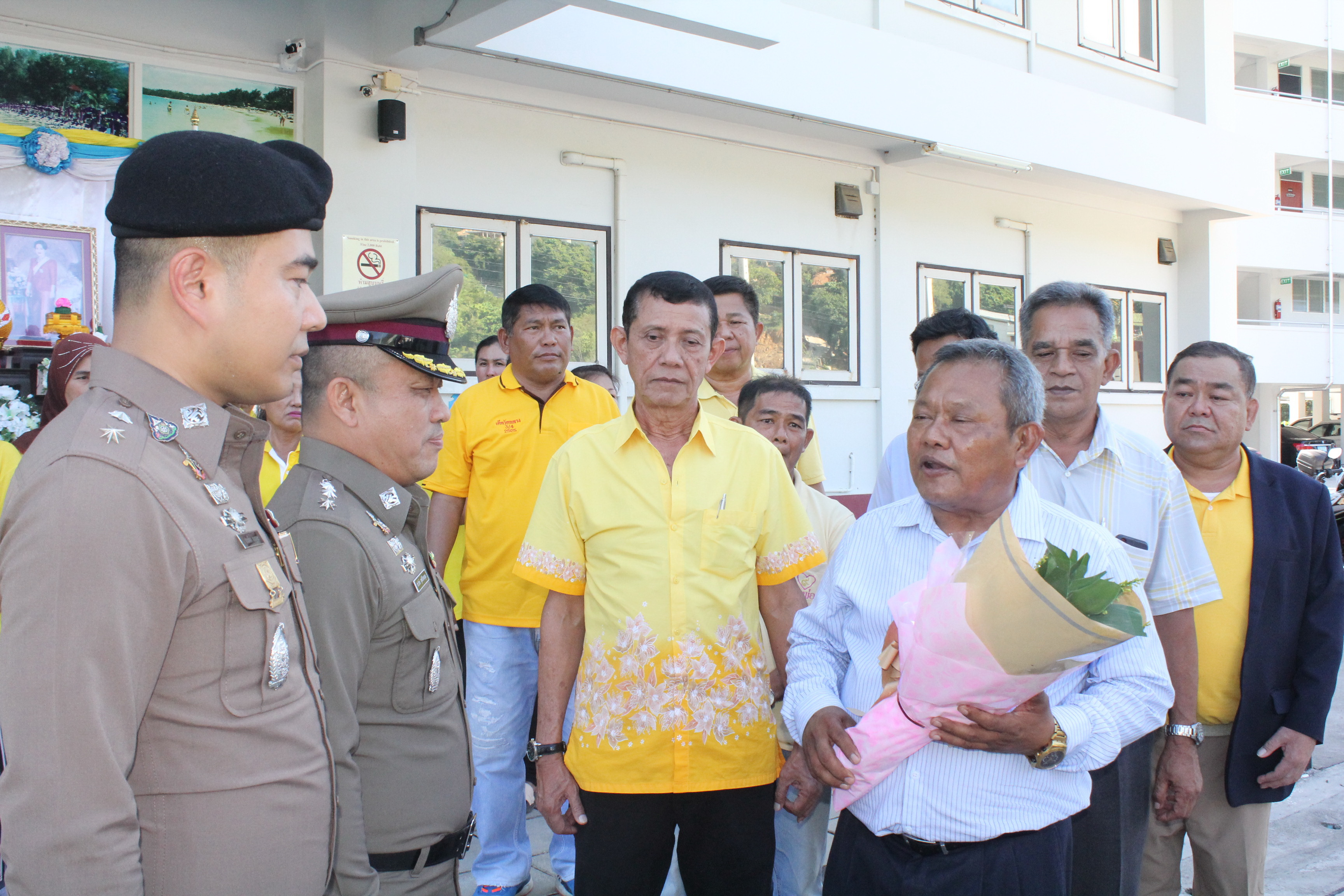 Locals giving a flower bouquet as a gesture of support to Prateung on Aug. 19.