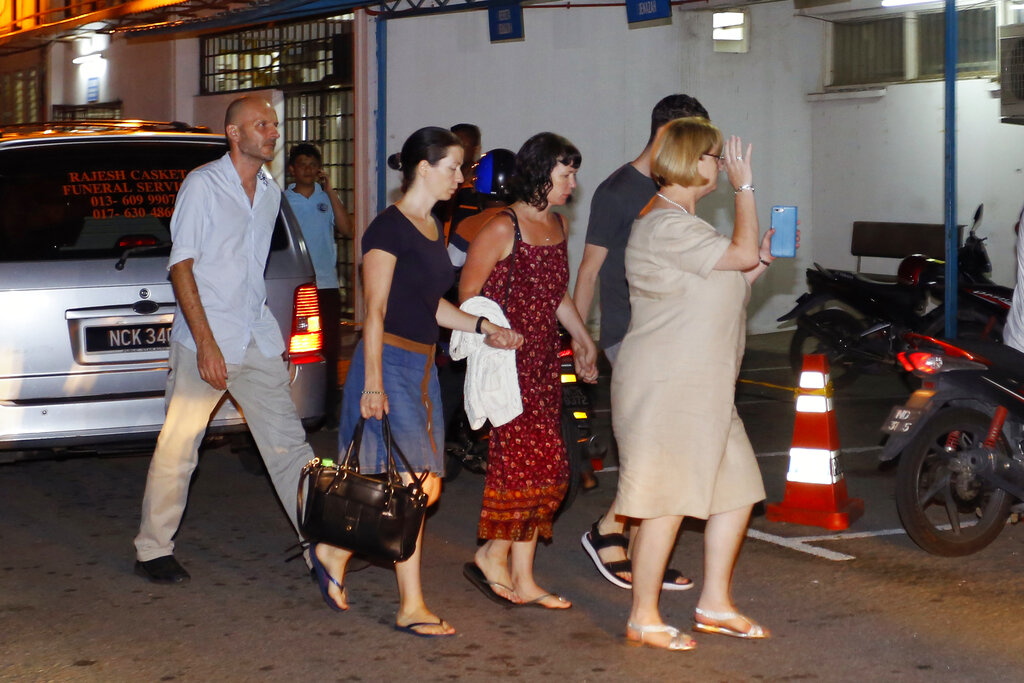Family members of missing British girl Nora Anne Quoirin arrive at a hospital morgue in Seremban, Negeri Sembilan, Malaysia, Tuesday, Aug. 13, 2019. Photo: Lai Seng Sin / AP
