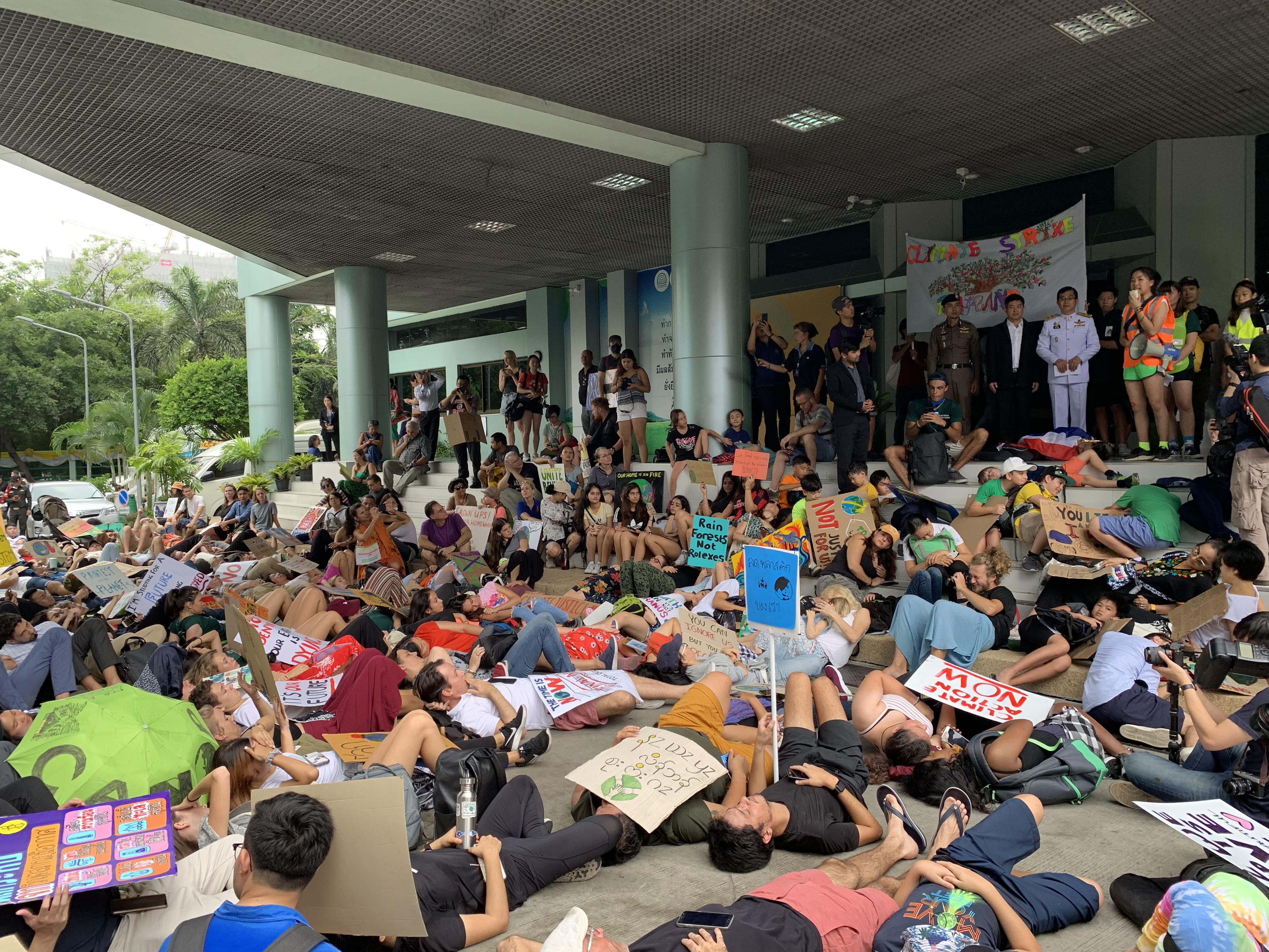 Protesters laying on the ground as a symbol for impacts of climate change.
