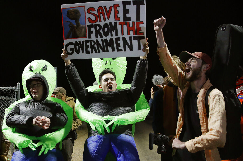 """Mario Rayna, center, chants with others at an entrance to the Nevada Test and Training Range near Area 51 Friday, Sept. 20, 2019, near Rachel, Nev. People gathered at the gate inspired by the """"Storm Area 51"""" internet hoax. Photo: John Locher / AP"""