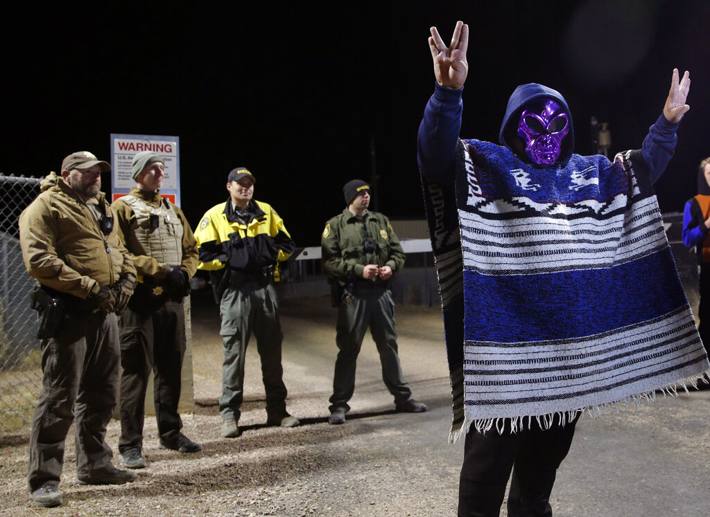 """A man in an alien mask stands at an entrance to the Nevada Test and Training Range near Area 51 Friday, Sept. 20, 2019, outside of Rachel, Nev. People gathered at the gate inspired by the """"Storm Area 51"""" internet hoax. Photo: John Locher / AP"""