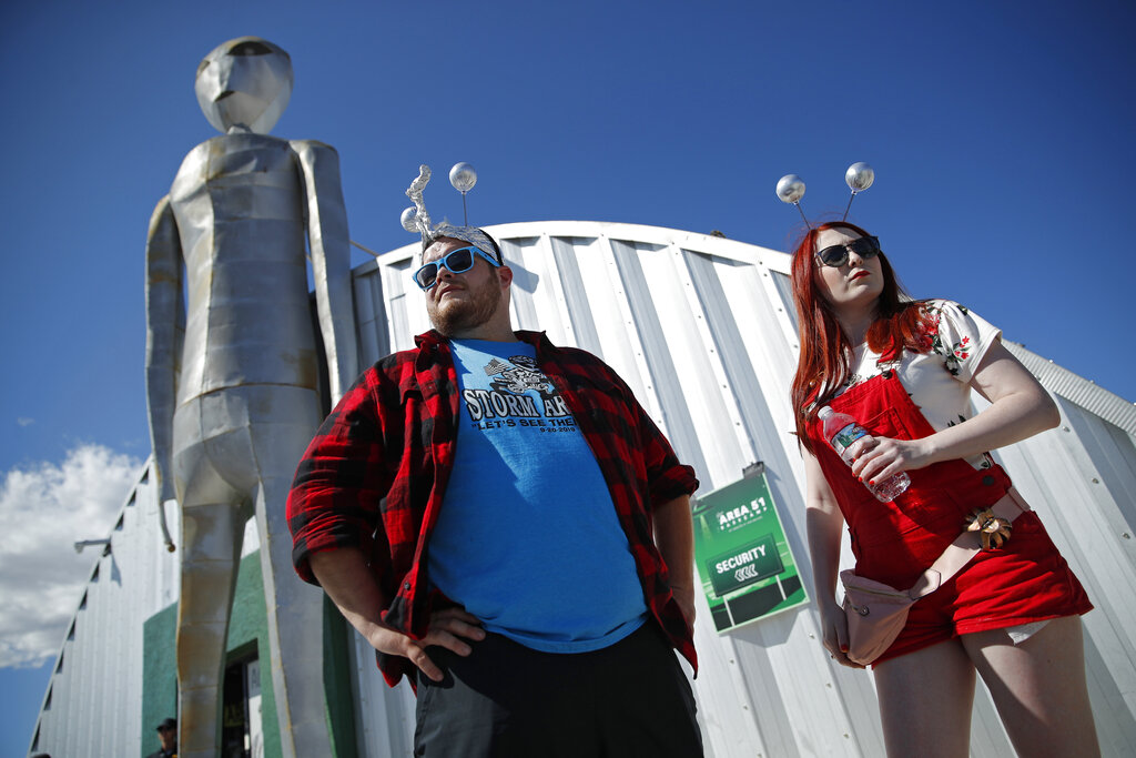 """Jackson Carter and Veronica Savage wait for passes to enter the Storm Area 51 Basecamp event Friday, Sept. 20, 2019, in Hiko, Nev. The event was inspired by the """"Storm Area 51"""" internet hoax. Photo: John Locher / AP"""