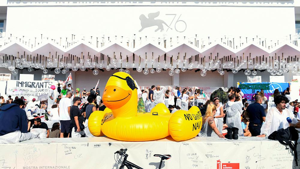Climate change protesters occupy the red carpet at the Venice Film Festival