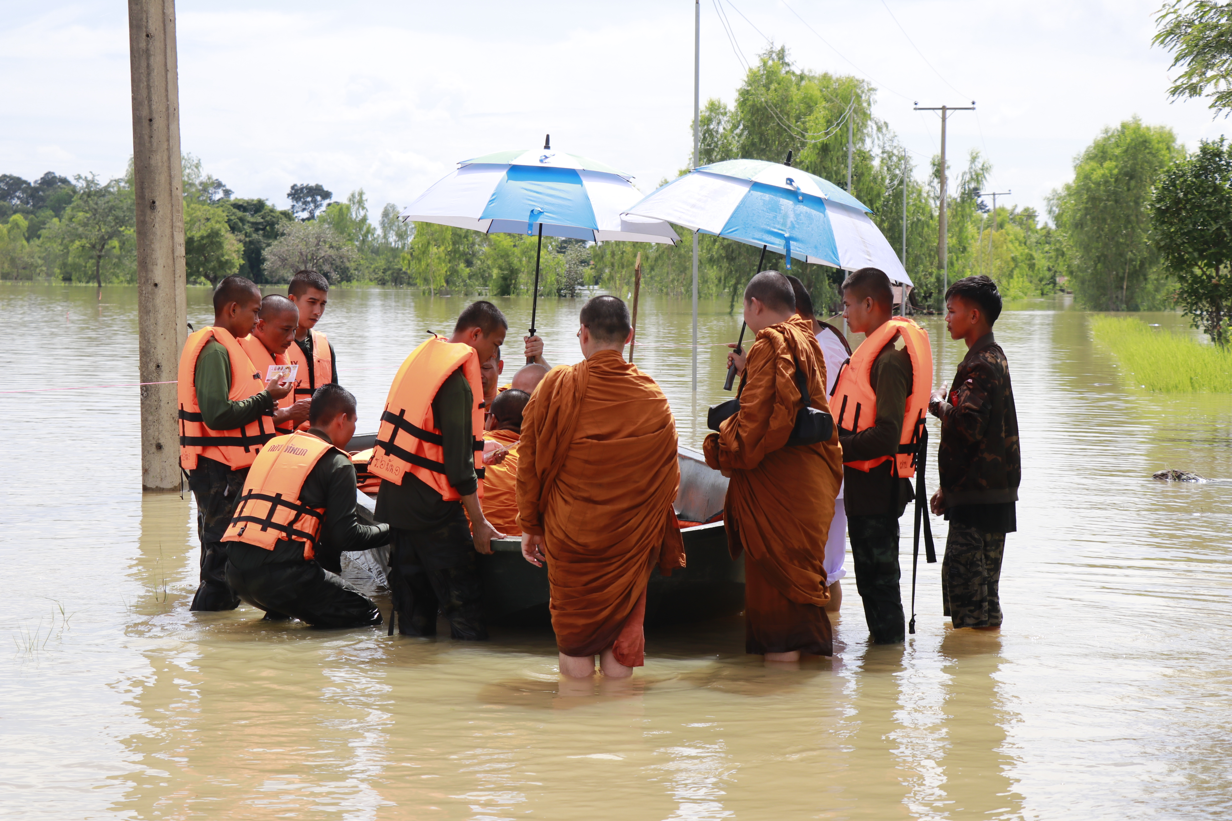 Monks being evacuated on Sept. 2 in Amnat Charoen.