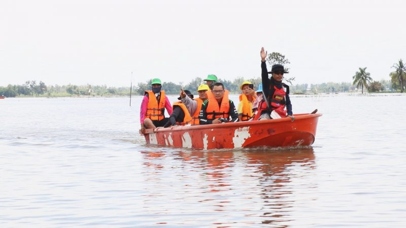 Rescue workers ride boats Sept. 15, 2019 in Wang-on Village in Roi Et province.
