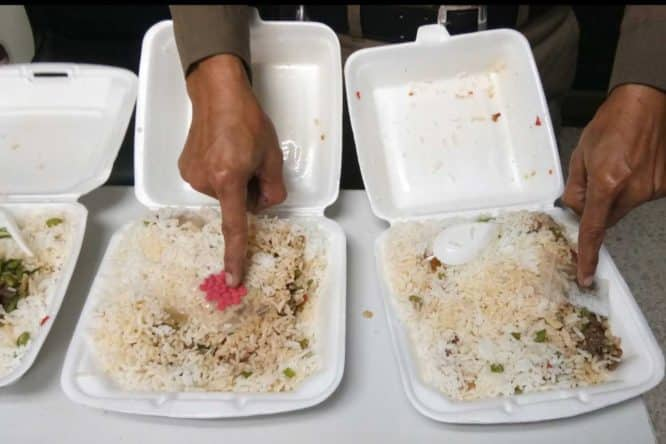 Video: Drugs smuggled into POLICE STATION in street food