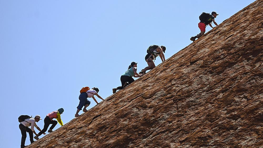 Australia's iconic rock Uluru, sacred to Indigenous population, scaled for final time