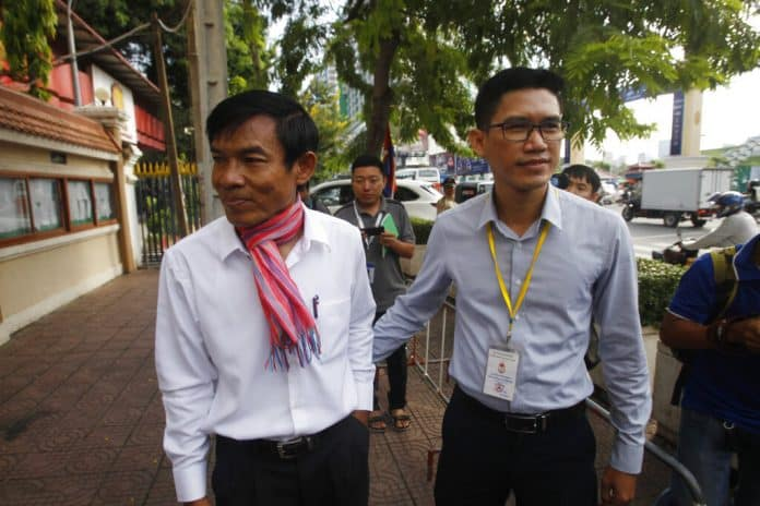 Cambodian Judge Orders New Probe in Reporters' Spying Case