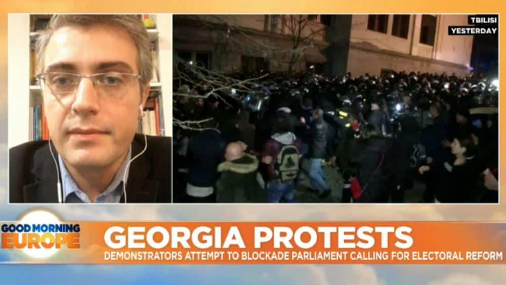 Georgian riot police deploy water cannon as protesters in Tbilisi try to blockade parliament