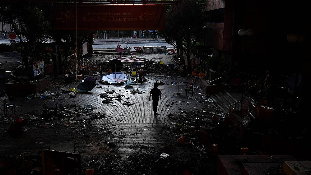 Hong Kong police to enter university as hunt for protesters turns up empty