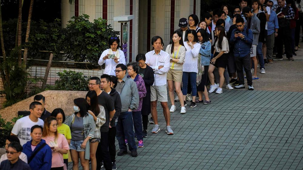 Hong Kong turns out in huge numbers for vote viewed as referendum on protests